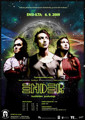 Three people stanging before a planet image on the Ender poster