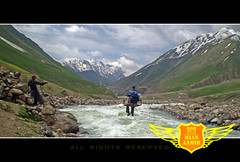 Crossing Kunhar River at UR ON RISK (One Way Ticket to.....!) (Mian Aamir) Tags: blue pakistan sky white mountains green ice water beautiful club clouds amazing crossing risk hiking july cable hiker annual lovely 2009 lahore aamir naran mian man river power pehc kunhar dodhipat eyewalks 03214699274