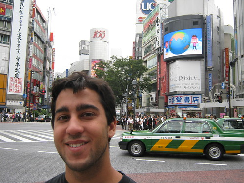 Above Davids head is the famous Shibuya 109 (BONUS: It looks like a taxi cab is about to drive into Daves ear).