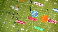 Sponsored by.. (TheFutureIsUnwritten) Tags: toronto canada game sports field advertising stadium arena cfl glassfloor blogto99cents