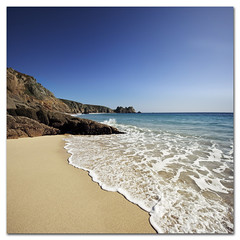 Beach, Cornwall, England. Dip your toes in and wash away those Monday blues... (s0ulsurfing) Tags: ocean uk travel blue light sea vacation england sky panorama cliff sunlight holiday seascape english tourism praia beach water beautiful beauty rock composition canon landscape outdoors bay coast mar sand october scenery rocks heaven paradise cornwall day skies bright pov cove wide perspective shoreline clarity blues wideangle nopeople tourist cliffs clear coastal shore beaches vista getty coastline watersedge landschaft 2009 porthcurno pristine rockformation tranquilscene kernow 10mm westcornwall logansrock sigma1020 beautyinnature loganrock s0ulsurfing staycation vertorama