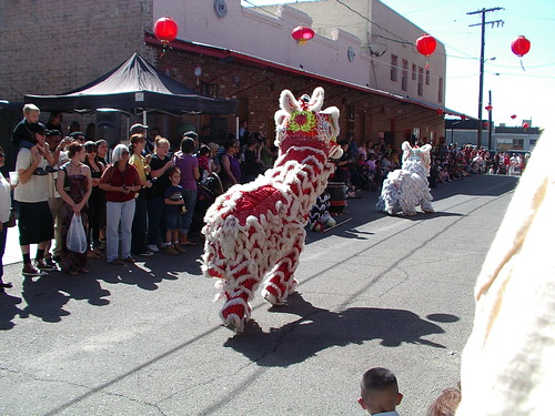red and whie lion dancers