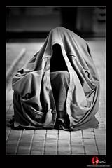 Old man under the coat (O-STUDIO) Tags: old city bw man nikon coat under osama kuwait hiding kuwaiti 70200mm almajed d700 megashot flickrlovers wwwosamaalmajedcom ostudio almubarakiah