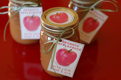 Jars of homemade organic applesauce with label by Eve Fox