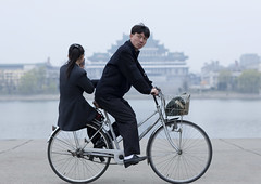 Riding on my bike in Pyongyang North Korea (Eric Lafforgue) Tags: pictures travel bike river photo war couple asia ride picture korea kimjongil asie coree velo journalist journalists northkorea pyongyang  dprk coreadelnorte juche kimilsung nordkorea lafforgue  ericlafforgue   coredunord coreadelnord  4627 northcorea coreedunord rdpc  insidenorthkorea  rpdc   coriadonorte  kimjongun coreiadonorte