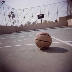 Basketball on rooftop - 04Nov08, Manama (Bahrain) (]) Tags: shadow terrain blur 120 6x6 film rooftop basketball sport ball square bahrain holga blurry fuji courtyard ombre scan pro analogue toit vignettage vignetting flou manama argentique carr balle bahrein pellicule 160s fujipro160s