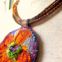 Cosmos detail new pic (fancypicnic) Tags: orange flower floral necklace beads silk commission pendant silvergrey fabricjewellery customorder textilejewellery