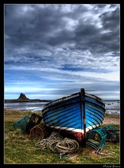 Lindisfarne Boat (Michael Brewis (Northumbrian Blue)) Tags: blue sea england sky cloud colour castle abandoned water clouds landscape geotagged landscapes boat north shoreline olympus rope northumberland shore northumbria capture holyisland lindisfarne finest e510 northumberlandlandscapesgeotagged