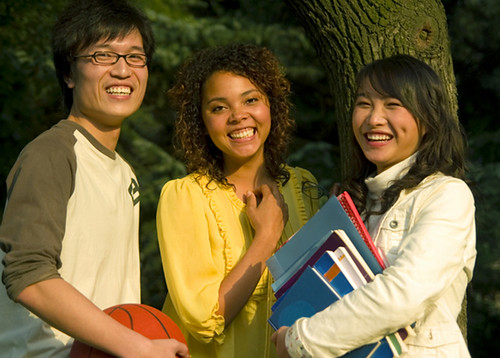 three students laughing image