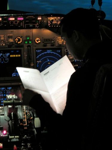 Reading the flight plan.
