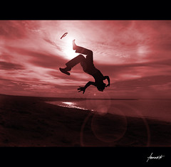 The Somersault. (Tomasito.!) Tags: boy sunset red portrait sun seascape man tourism beach beautiful silhouette wonderful fun yahoo google interesting jump nikon flickr philippines surreal manipulation tourist explore lensflare flipflops flare acrobat camiguin frontpage jt slipper slippers stunt acrobatic sunflare havianas noriega somersault summersault tomasito d90 nikond90 mygearandmepremium mygearandmebronze mygearandmesilver mygearandmegold camigin