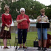 Vanessa Martell, Elvera Cullen, and a Boy Scout honoring...