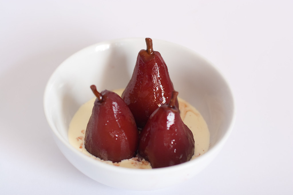 Pears poached in red wine and bay with cinnamon cream.