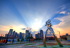 Traveling Man (maconahey) Tags: street new city sunset urban usa sun man building art station skyline clouds skyscraper canon buildings dallas downtown ray texas tx deep beam dfw traveling 2009 dart hdr deepellum ellum 30d photomatix canon30d 5photosaday travelingman maconahey