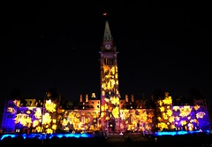 Proudly Canadian Night (GlossyEye.) Tags: colors night spectacular wonder landscape maple colours peaceful projection 55mm sound canadians lightshow parliamenthill peacekeepers 18mm proyection projecting peacemakers perfectexposure proudlycanadian dailythings dramaticcolor nikond40 thrillingcomposition storyofourcountry storiesandvision spiritofacountry multiculturalcountry aoneofakind picnikorpicnic