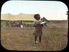 Small child in front of tents (The Field Museum Library) Tags: africa expedition child kenya 1906 mammals 1905 lanternslide britisheastafrica carlakeley zoologyexpedition handcoloredglasslanternslide