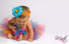 Baby in a Bright Tutu (FLPhotonut) Tags: portrait baby flower colorful bright whitebackground tutu headband homestudio canon50d flphotonut interfit150exmkii