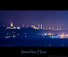 Istanblue Haze (Kuzeytac) Tags: blue sea color colour tower silhouette night turkey landscape haze cityscape purple minaret