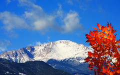 Pikes Peak Mountain with the tundra crown covered in snow on this clear fall day (Beverly & Pack) Tags: travel blue autumn winter red vacation sky orange white mountain snow mountains cold tree fall sports colors leaves yellow colo clouds photoshop photography photo leaf maple colorado colorful mt skiing seasons bright image top hill extreme picture rocky pic denver mount covered coloradosprings co plugin crown aspen puffy pikespeak redfield fractaliusfilter