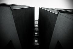 (belle haleine) Tags: winter sky berlin architecture canon eos grey wideangle checkpointcharlie eisenmann 1118 berlino berlinarchitecture eos450d tamron1118 450d hausamcheckpointcharlie graziefr