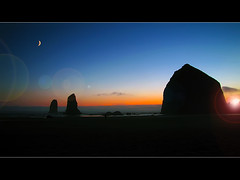 Sunset at Cannon Beach (David Gn Photography) Tags: ocean sunset sky moon seascape beach oregon pacific oregoncoast cannonbeach haystackrock canonpowershotsx1is