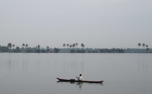 Lone boatman on the lake