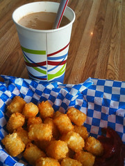 Chocolate banana milkshake and seasoned tots