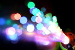 Fiber Optic Toy (Audiotribe) Tags: blue light red orange abstract blur color colour green art colors yellow canon fun denmark toy toys eos 50mm focus exposure dof led lys danmark depth fiberoptics fiberoptic diode fokus sooc 400d beyondbokeh