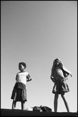 Girls on the roof, Kalahari, Namibia (Izla Kaya Bardavid) Tags: africa girls people girl kids rural children san village child traditional ethnic namibia kalahari backandwhite afrique bushmen younggirls kalaharidesert sanpeople bushmanland