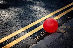 Party's Over (nzbuu) Tags: road street city cambridge england urban tarmac unitedkingdom balloon gimp things explore redballoon doubleyellowlines ufraw millroad canonef50mmf18ii canoneos450d