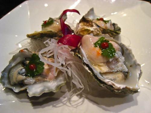 Kumamoto Oyster with sriracha and cilantro