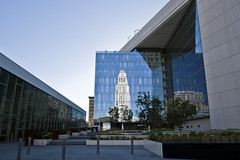 City Hall Reflected in LAPD HQ (johnwilliamsphd) Tags: city blue sky copyright reflection glass stone architecture buildings john la losangeles williams cityhall c police headquarters hq 2009 department lapd aecom  williams john dmjm johncwilliams hampn johnwilliamsphd phd