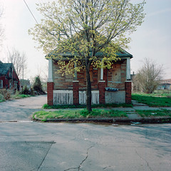 Abandoned house in Detroit, Michigan (Kevin Bauman) Tags: city houses homes urban house brick abandoned film home architecture facade peeling paint downtown exterior decay michigan empty small bricks detroit snowstorm hasselblad abandonedhouse isolation peelingpaint abandonment isolated decaying crumbling dysfunctional pealingpaint abandonedhouses