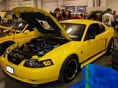 2009 Autofest (Adventurer Dustin Holmes) Tags: cars ford 2004 car yellow one 1 automobile 04 fast vehicles transportation vehicle mustang fords automobiles carshow mustangs sportscar sportscars mach carshows autofest 11thannual february2009 february09 2009autofest oreillyautofest oreillyautopartsautofest autofest09