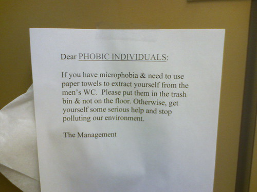Dear PHOBIC INDIVIDUALS: If you have microphobia & need to use paper towels to extract yourself from the men's WC. Please put them in the trash bin & not on the floor. Otherwise, get yourself some serious help and stop polluting our environment. The Management