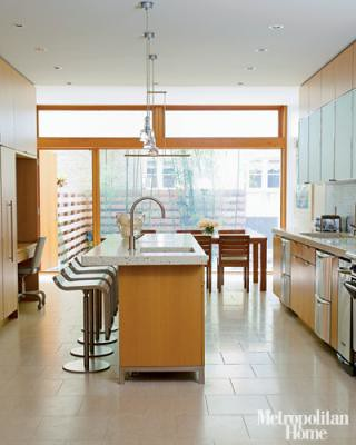 Modern, light-filled kitchen: Concrete counters + limestone floors, from Met Home