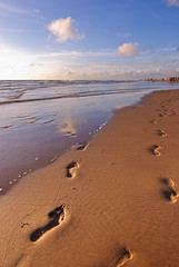On the beach (andy.wolf) Tags: sea sun beach water clouds sand toes footprints bluesky shore d80 1424mmf28g