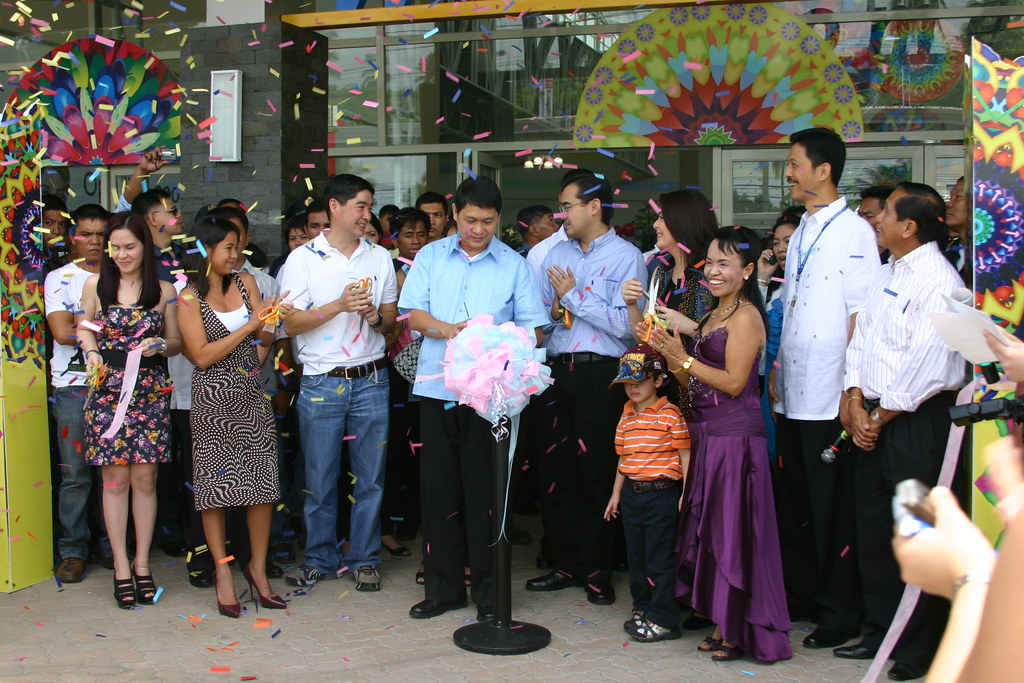 Mayor Acharon raises the ribbon after its ceremonius cutting with other special guests.
