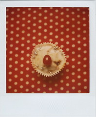 polka (Lizzie Staley) Tags: red white catchycolors polaroid sx70 polka dot cupcake 779 cmwdred