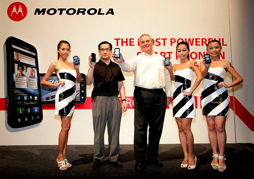 Andy Tan, CEO of Brightstar Distributions Sdn Bhd and Robert Van Tilburg, Senior Regional Sales Director, Motorola Mobility, South Asia posing with models at the launch of Motorola Atrix.
