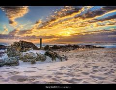 Sand and Sun ([ Kane ]) Tags: ocean sky sun beach water clouds sand rocks pole explore qld kane hdr currumbin gledhill kanegledhill vosplusbellesphotos humanhabits kanegledhillphotography