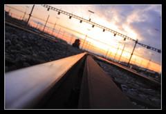 Sunset Train (Zditch) Tags: trip travel sky sun art nature beautiful clouds train canon eos switzerland soleil photo amazing nice photographie view suisse pics d lausanne rails nuage 450 vaud renens perspectiv shweiz