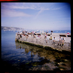 """Bloody hell not those kids again - spose I will just have to go for this last piece of bacon!  AAAArrrrggghhhh!!!!"" (Loulou H) Tags: 120 holga slidefilm dorset fujichrome swanage bankholiday crabbing"