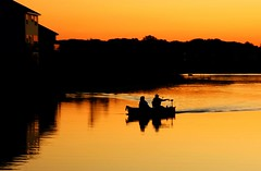 Boat Ride at Sundown (LynnF1024) Tags: sunset sky lake color nature water minnesota silhouette evening boat raw nikond40 todaysbest funfanphotos lynnf1024