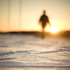 Man Walks Into Sunsrise Never To Return (koinis) Tags: light shadow snow sunrise canon john walking 50mm golden dof bokeh explore figure 18 frontpage sqr 500x500 hbw twtmeblogged koinberg koinis enbrabild winner500