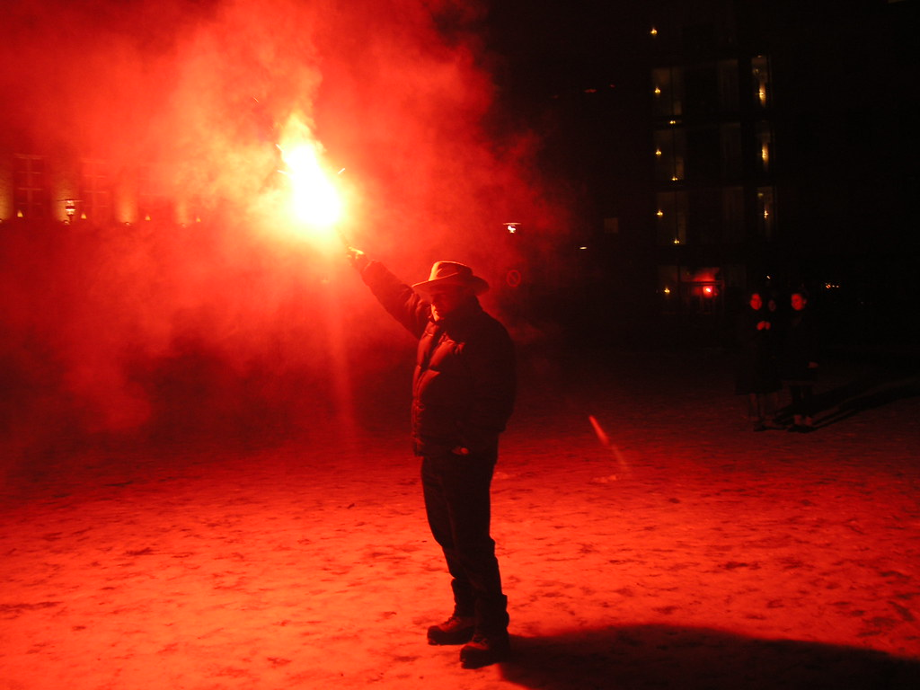Man with emergency flare