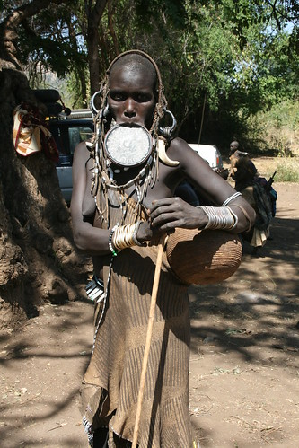 Mursi woman with lip-plate and other adornments