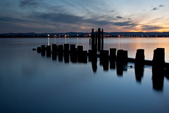 After sunset on the Columbia (dannotti) Tags: longexposure sunset sky orange reflection beach nature water delete10 vancouver clouds canon river delete9 delete5 outdoors lights delete2 washington dusk delete6 delete7 save3 delete8 delete3 columbia delete delete4 save save2 save4 columbiariver pacificnorthwest save5 piling 25seconds canon50d