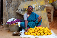 A Deal that she could not refuse (Kausthub) Tags: people woman india fruit portraits mango handheld dslr peddler 2009 mahabalipuram fruitseller streethawker leicalens platinumphoto canoneos5dmarkii leicarsummilux80mmf14lens