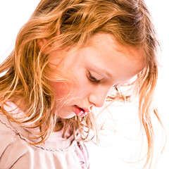 Young girl gazing down